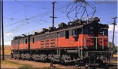 Milwaukee Road boxcab #E57B runs light through the once large terminal in Harlowton, Montana during August of 1971 working as a yard switcher. These motors remained in service on the Milwaukee for nearly 60 years.