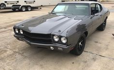 70 chevelle grey with painted bumpers and black trim and wheels