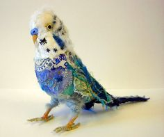 Karen Suzuki creates some really whimsical textile birds, animals and dolls. She combines textiles with embroidery and found objects.  You can more of her work on her website at https://namelesswonders.jimdo.com/