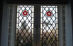 Tudor rose leaded windows. 4 panels. 1.7m high x 0.5m wide.