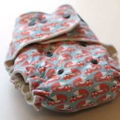 PERSNICKETY - Fox Fitted // One Size fitted with 9 layers. Persnickety Fox Natural Cloth Diaper is composed of three natural diaper layers plus a three layered double-petal soaker for a total of 9 absorbent natural fabric layers.