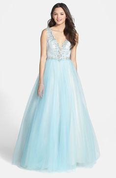 Free shipping and returns on Mac Duggal 'The Elsa' Deep V-Neck Ballgown at Nordstrom.com. This icy blue gown is fit for a princess with its stunning, deep-V bodice bedecked in crystal snowflakes. Cool blue tulle creates soft, flowing contrast atop the voluminous ballgown skirt, and a dipped back ensures a lovely view from all angles.