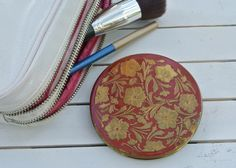 You can't help but evoke the glam of the 1940s when you slip this red enamel powder compact from your purse. Filled with one ounce of my botanical beeswax perfume of your choice, the combination of vintage compact and beeswax perfume is a delight to all your senses.   Rex Fifth Avenue Powder Compact, Perfume Compact, Raised Pansies Brass Red Enamel Compact, Beeswax Perfume, Solid Perfume, Vintage Compact by JanesAromaScents on Etsy