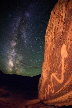 The photo above shows a particularly long (approximately 9 ft or 3 m) serpent petroglyph found in the San Rafael Swell of east central Utah. Very little has changed at this spot since the petroglyphs here were first painted some 2,000 years ago. The serpent, rock face and Milky Way look now much as they did then.