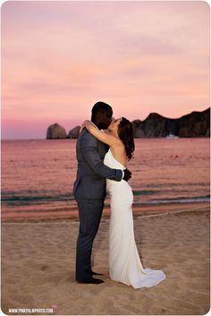 Bride & groom kiss at sunset on their wedding day in Cabo San Lucas, Mexico. #cabosanlucas #cabowedding #loscaboswedding #destinationwedding #mexicowedding #bajawedding #weddingphotographers #loscabosweddingphotographers #caboweddingphotographers #bridetobe #wedspiration