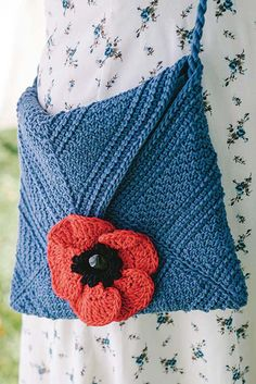 A poppy serves as the buttonhole for the bright cotton Perennial Purse. The body is crocheted in a mitered square of textured Tunisian stitches, alternating bars of reverse stitch stripes, and honeycomb; the corners of the square are folded up into an envelope. Get the pattern in Interweave Crochet Spring 2017.
