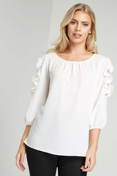 Cold Shoulder Frill Detail Top - Free UK Delivery - 10 12 14 16 18 20 - Take a feminine approach to dressing this season. This soft woven top boasts sweet textured ruffles trimming the oh-so trendy cold shoulder. Perfect for dressing up and down, style with jeans and flats for an ultra-feminine look. - Romanoriginals.co.uk