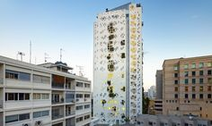 French architect Jean Nouvel brought a vibrant multi-use project to life in downtown Nicosia, Cyprus, and the building's pixelated design is built around creatively incorporated space for lush green plants on nearly every floor.