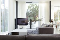 Living-Rooms-Marvelous-open-living-room-idea-design-equipped-with-agreeable-white-window-curtain-decorate-likewise-lovely-modern-white-coffee-table-designs