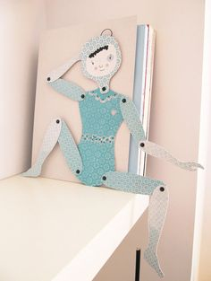Art doll made out of cardstock, to sit on a shelve.