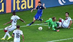 Messi (centre) pokes the ball past Neuer but Germany clear