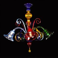 Artistic #Murano's #chandelier worked exclusively by hand with the ancient art of #Murano #glass masters from #Venice. Visit our web site www.sognidicristallo.it to see or buy online our creations! Price with 5 lights 475 euro - 660 $