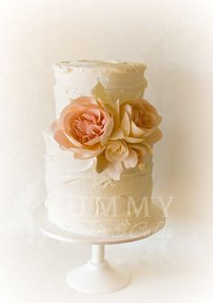 A 2 tier Extended height Rustic Charm adorned with sugar David Austin roses in blush and dusty pink.