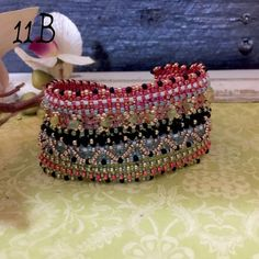 Mardi Gras beaded cuff bracelet Just about that time of year!  A great accessory to celebrate Fat Tuesday! This bracelet is approx a size 7. Can adjust if needed. IEdesigned Jewelry Bracelets