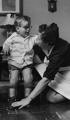 A boy with cerebral palsy learns how to use leg braces with the help of a visiting nurse about 1960. See more pictures at https://www.facebook.com/media/set/?set=a.447468683338.240730.99588788338----I didn't have physical therpy until I learned to walk on crutches. I learned how to walk on crutches at five or six.
