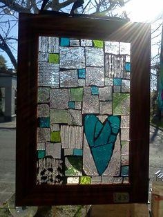 Mosiac Glass hearts from scraps of glass and thrift store picture frames.
