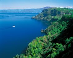 Lake Towada. Around 2000 years ago, volcanic activities gave birth to Lake Towada, a double caldera at 400 m (1312 feet) above sea level. Lake Towada's beauty can be ap