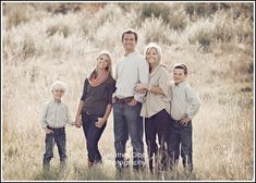 I Really like the casual denim, but LoVe the background a lot!! I like the brown tall grassy back grounds.   Family picture idea pop of coral with neutrals!