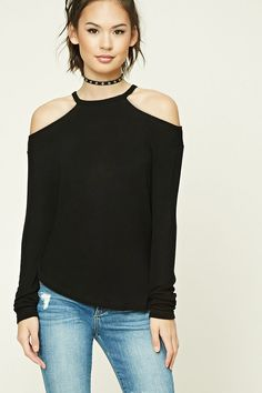 A lightweight knit sweater featuring an open-shoulder design, a round neckline, and long sleeves.
