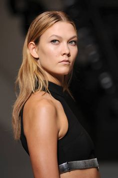 Models Karlie Kloss (pictured) and the brand's new muse Georgia May Jagger walked at the Thierry Mugler show looking fresh-faced with minimal makeup and clear centre partings. We've said it before, but this hairstyle detail really is the easiest way to update your look for next season.
