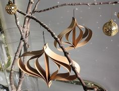 The CC's home made wood veneer ornaments. by rosanne