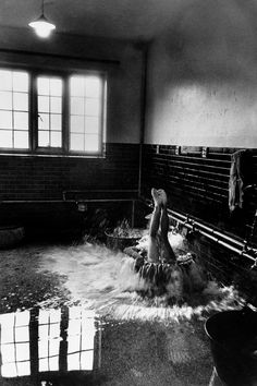 Early morning cold baths, Winchester College, England, 1951 - by Cornell Capa (1918 - 2008), Hungarian
