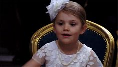 Princess Estelle waves to her cousin Princess Leonore and aunt Princess Madeleine at her brother's christening