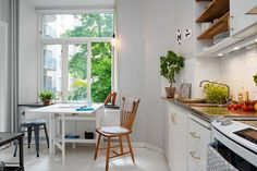 Adorable tiny apartment with intriguing layout in Sweden The kitchen offers space for both cooking and dining table. The kitchen can accommodate two to four people but also six seated guests have been possible in this social kitchen.