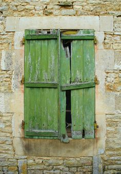 old green shuttered window