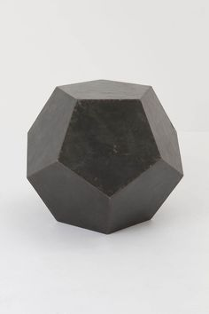 Torque stool from Anthropologie. A geometric chunk of pyrite. / Would like to see this used as a coffee table.