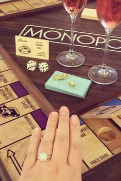 This man popped the question with a tailor-made Monopoly game! You have to read their adorable proposal story.