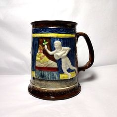 Ebenezer Scrooge with The Ghost of Christmas Past from A Christmas Carol by Charles Dickens. 1975 Beswick Yule tankard.