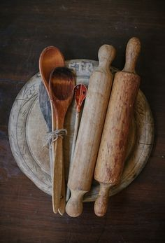 vintage wooden bread board, rolling pins and spoons