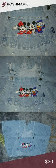 Disney Mickey Overalls Vintage Disney Mickey Overalls in size Large. Fits as a cool oversize for medium. Very soft and in great condition with one flaw. Please see photo #5 to show the tear at the button one slot underneath on the left side, price reflects. The front top is so neat with Mickey, Mini and Donald Duck and some awesome pockets!   Reasonable offers welcome.  Bundle to save 20%.  Happy Poshing :) Disney Jeans