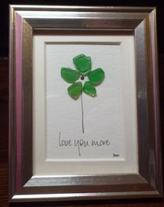 Love you more is an original design featuring a flower made from green sea glass with hand lettering in a mini 3 3/4 x 4 3/4 frame. The sea glass in this piece is from my personal collection that I hand collected along the shore in Connecticut. As with all of my artwork, each piece is an original and once that piece is sold, I can create a custom duplicate - made to order and includes the matting and frame, making it a complete piece; perfect for gift giving. Each piece pictured is the…
