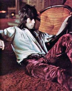 Keith Richards in open silky shirt and velvet pants. Great hair.