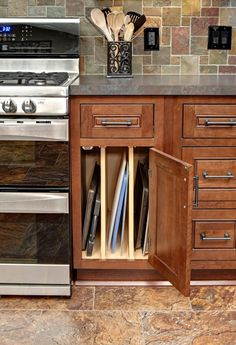 cherry inset traditional cabinets with baking sheet organizer storage