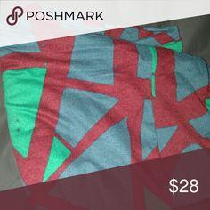 BNWT Lularoe geometric leggings OS leggings BNWT. Geometric design - blue and green on a dark reddish background. Random speckles scattered throughout. LuLaRoe Pants Leggings