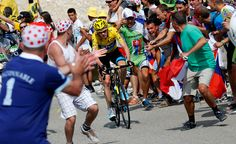 Supporters cheer overall leader's yellow jersey Britain's Christopher Froome during the 242.5 km fifteenth stage of the 100th edition of the Tour de France cycling race on July 14, 2013 between Givors and Mont Ventoux, southeastern France.