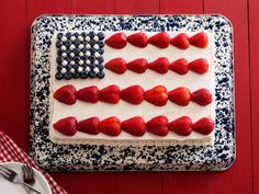 Recipe of the Day: This Flag Cake is covered in a buttery white chocolate frosting. The sprinkle-studded cake is decorated with fresh berries to reflect the American flag. #FlagCake #Dessert #Berries