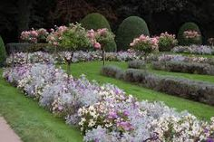 Beds are filled with lilac Petunias, white Begonias, and silver Artemesia.