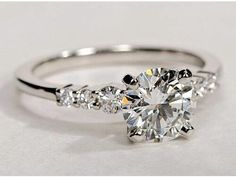 This!! Except with an cushion cut large stone. This is the ring my fiancée gave me while we were vacationing in Rome!