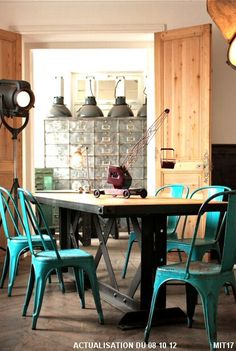 Dining table / desk design from architectural elements EIFFEL 1900 riveted steel beam lattice, vintage rough oak board. Feasible to measure. Beautiful aqua blue Tolix chairs.