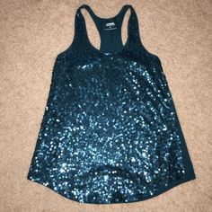 Express teal sequined tank top women's size XS Women's sequined tank top in teal size XS. Super cute color! Looks great with jeans  tank is in perfect condition. No trades  Express Tops Tank Tops