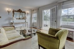 The main level of this Westhampton estate offers an inviting living room with original fireplace and French doors leading out to a covered porch. For more details contact Peggy Kisla, Licensed Real Estate Salesperson, 631.288.3030.  #realestate #hamptonsrealestate #westhampton #luxuryrealestate #historichomes #lifestyle #forsale #hamptonshome #hamptonclassic #properties #househunting #estate