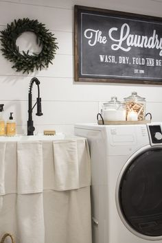 Got a builder-boring laundry room? Take a look at this farmhouse laundry room makeover for ideas to improve your own laundry space!