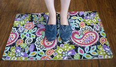 Mod Podge a kitchen rug with the same, or coordinating fabric, as used elsewhere in the kitchen!
