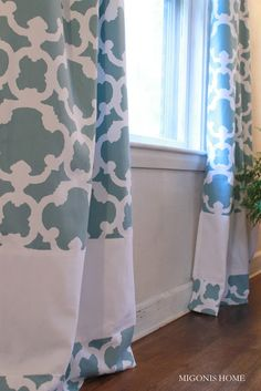 Make standard 84 inch curtains longer  Cut the curtains near the bottom and sew a white band in between the two pieces.  Migonis Home: Makeover Monday: Living Room Windows