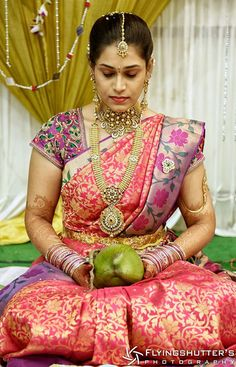 South Indian bride. Temple Indian bridal jewelry. Jhumkis.Pink silk kanchipuram sari.Braid with fresh jasmine flowers. Tamil bride. Telugu bride. Kannada bride. Hindu bride. Malayalee bride.Kerala bride.South Indian wedding.