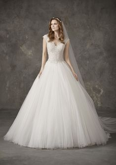 Nares is a marvellous wedding dress with full princess skirt crafted in tulle and bodice with thread embroidery and beading Disney Princess Dresses, Princess Wedding Dresses, Bridal Dresses, Pronovias Wedding Dress, Elegant Wedding Dress, Gown Wedding, Wedding Dress Shopping, Wedding Looks, The Dress